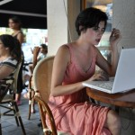woman with lap top in Tel Aviv cafe